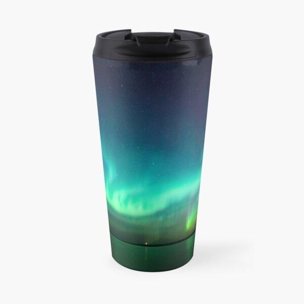 Northern lights glow over lake Travel Mug