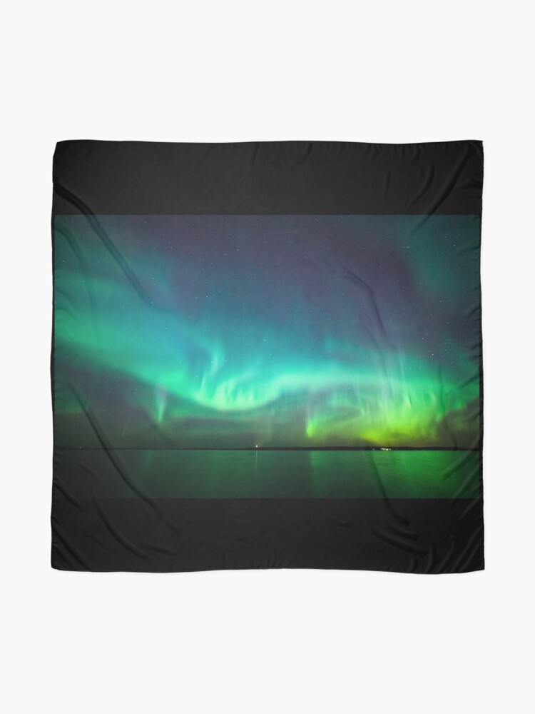 Alternate view of Northern lights glow over lake Scarf