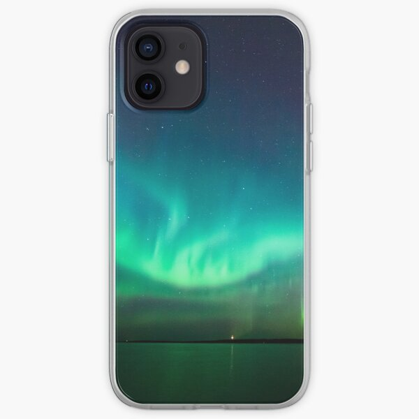 Northern lights glow over lake iPhone Soft Case