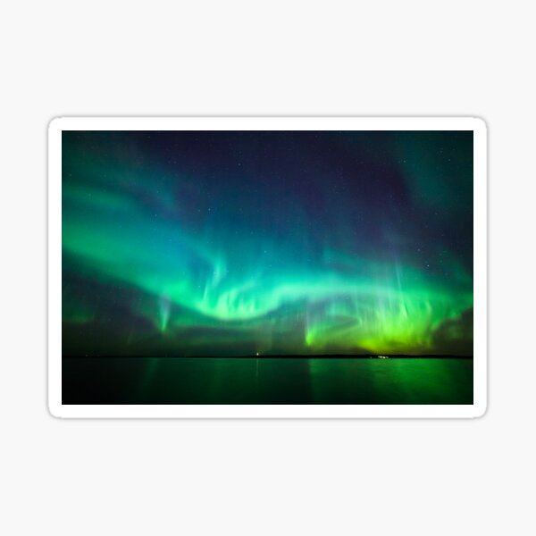 Northern lights glow over lake Sticker