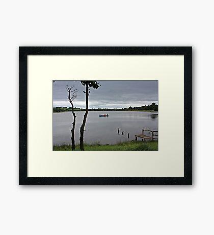 Three Men In Boat Framed Print