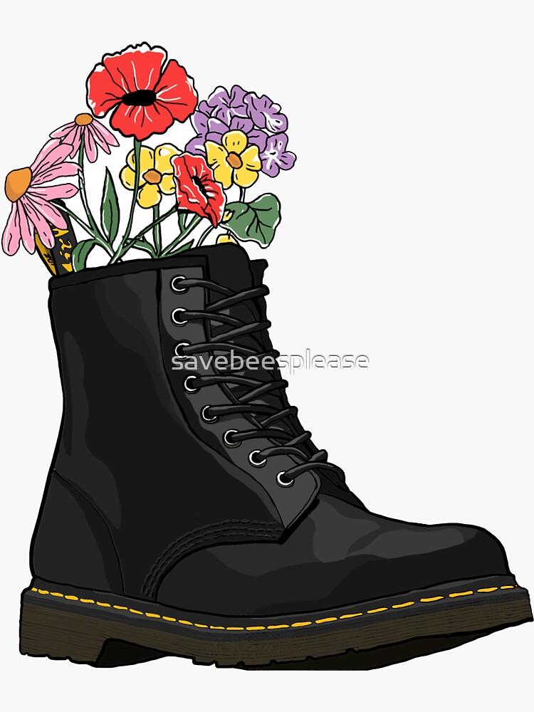 flowers growing from doc marten boot by savebeesplease