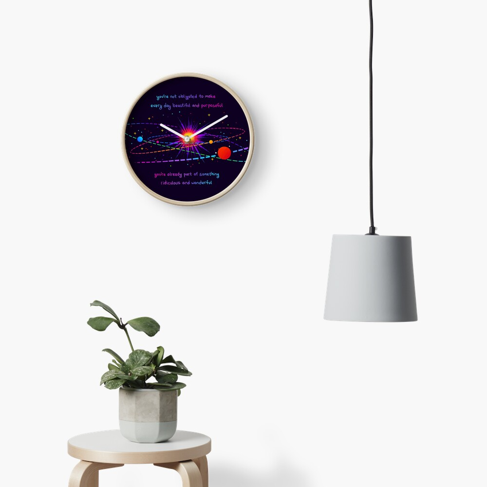 """You're Already Part of Something Ridiculous and Wonderful"" Solar System Clock"