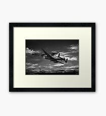 Lancaster Bomber On Night Raid Framed Print