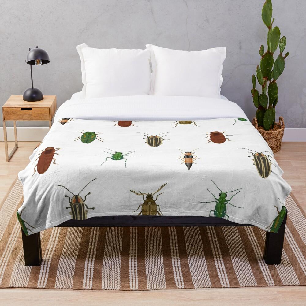 Four Beetles Throw Blanket