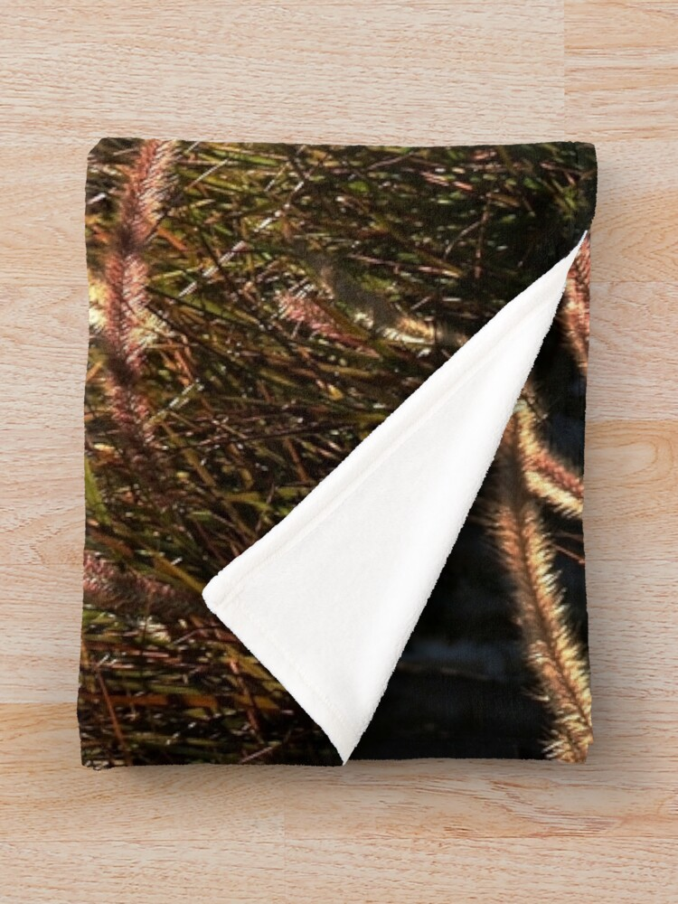 Alternate view of Sunset on the grass from A Gardener's Notebook Throw Blanket