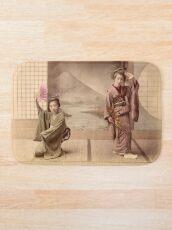 Two geisha girls dancing Bath Mat