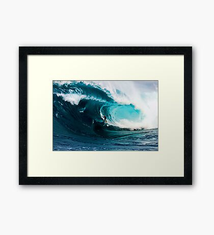A surfer takes on Shipstern Bluff Framed Print