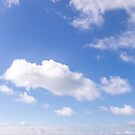 Aqua seas and blue skies with fluffy clouds by Zoe Power