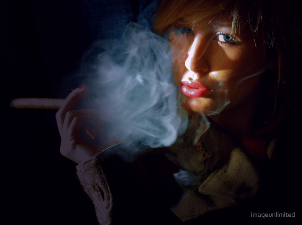 Blonde beauty in army jacket smoking cigar by imageunlimited