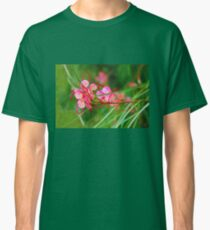 Floral background of grass and red flowers  Classic T-Shirt