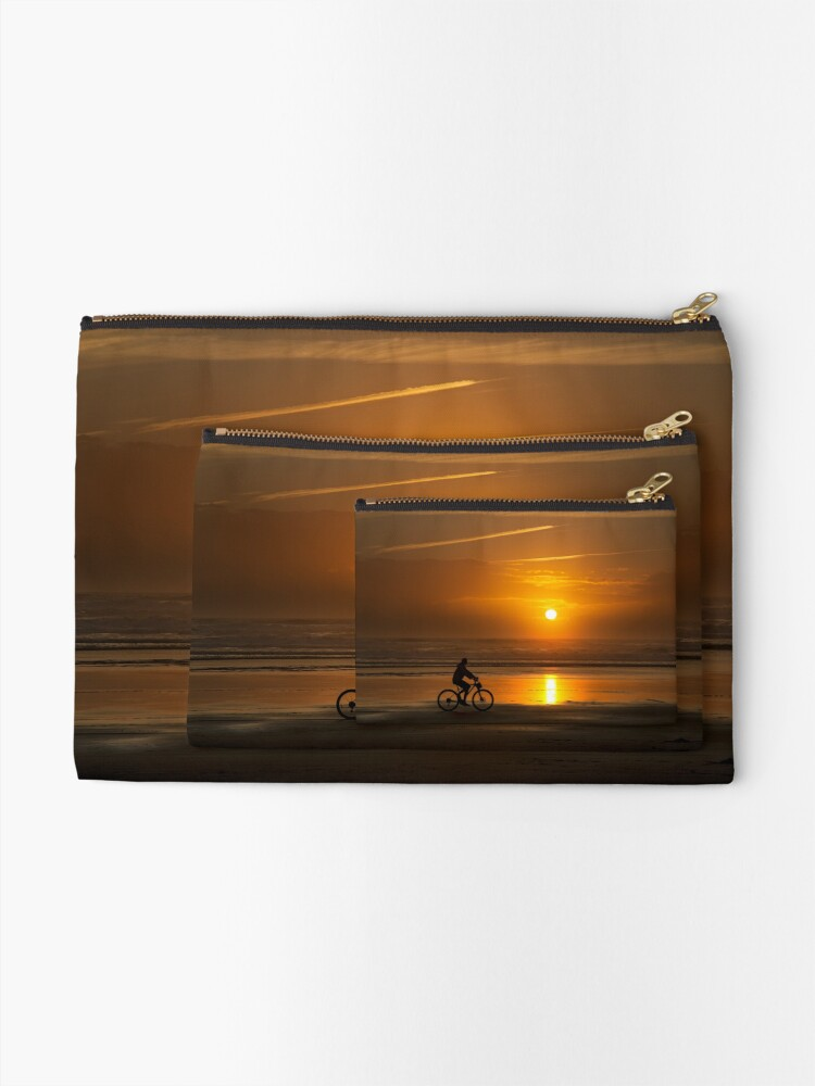 Alternate view of Silhouette of a cyclist along Cannon Beach Oregon Zipper Pouch