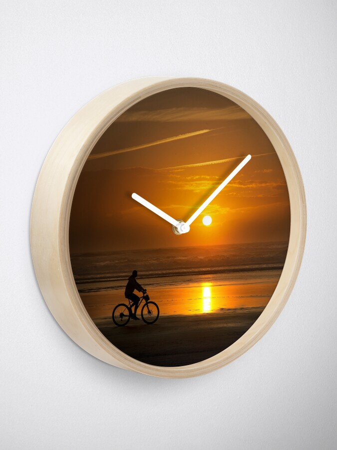Alternate view of Silhouette of a cyclist along Cannon Beach Oregon Clock