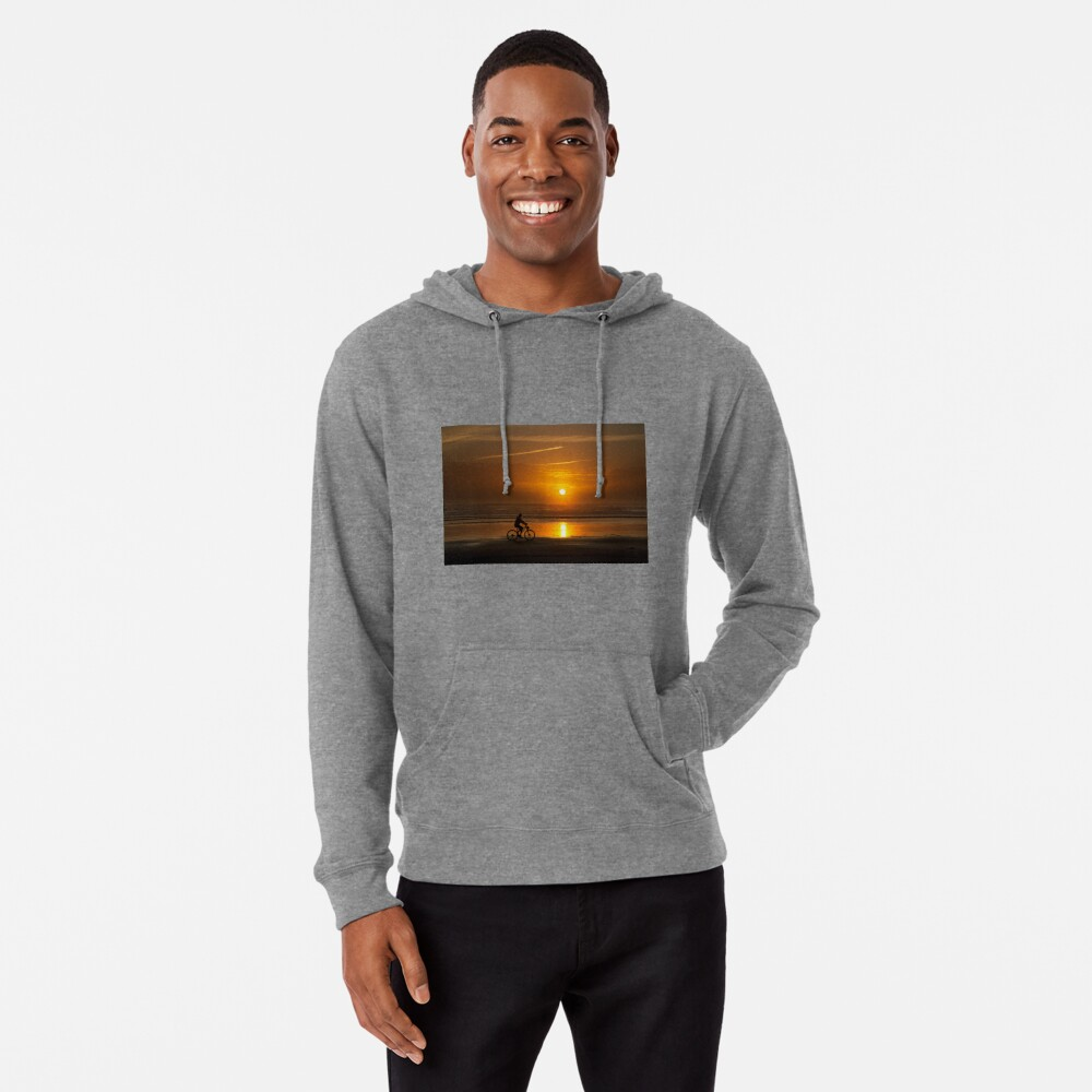 Silhouette of a cyclist along Cannon Beach Oregon Lightweight Hoodie