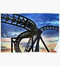 Coaster - Twisting frame of a roller coaster taken against a pastel sunrise Poster