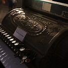 Old cash register by Oceanna Solloway
