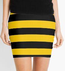 Schwarze und gelbe Streifen des Bienenmusters Minirock