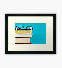 Black glasses and old books.  Framed Print