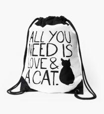 Mochila saco Todo lo que necesitas es amor y un gato