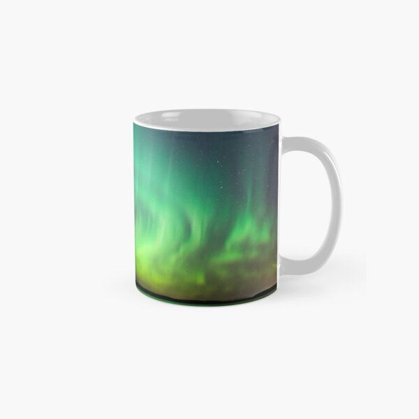 Northern lights over lake in Finland Classic Mug