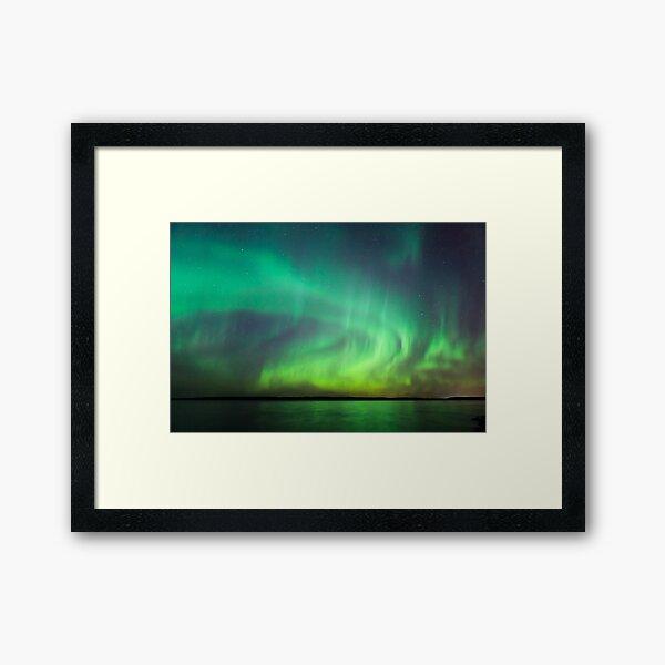 Northern lights over lake in Finland Framed Art Print