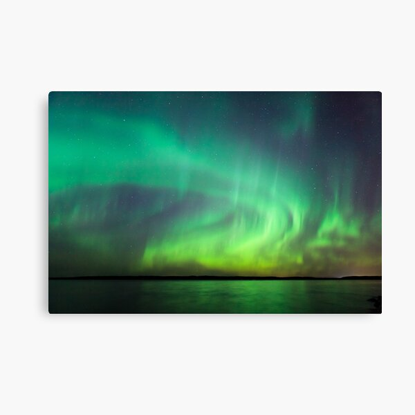 Northern lights over lake in Finland Canvas Print