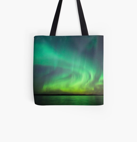 Northern lights over lake in Finland All Over Print Tote Bag