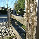 Wooden fence by Oceanna Solloway