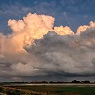 Colored clouds above the landscape by Adri  Padmos