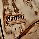 Rusted old Chevrolet  by Michelle Crouch