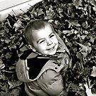 Tom loves the leaves ! by lendale