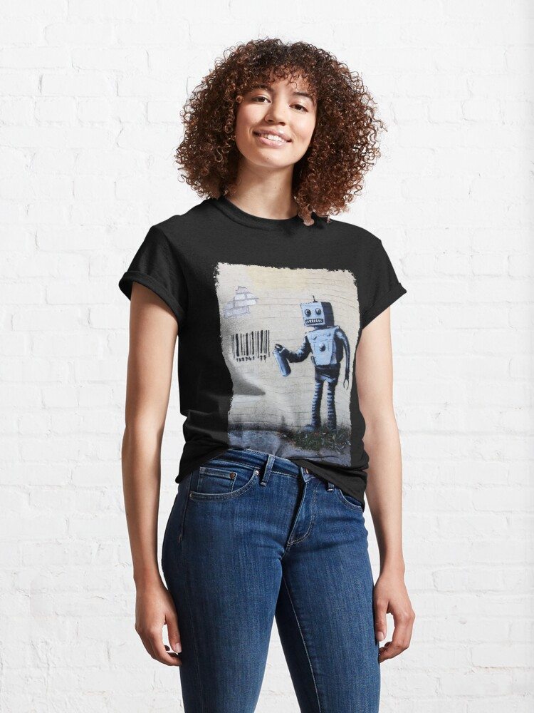 Alternate view of Banksy graffiti smiling Robot and barcodes Better Out Than In New York City residency on brick wall Classic T-Shirt