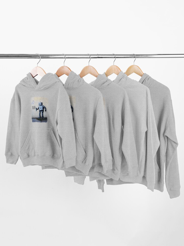 Alternate view of Banksy graffiti smiling Robot and barcodes Better Out Than In New York City residency on brick wall Kids Pullover Hoodie
