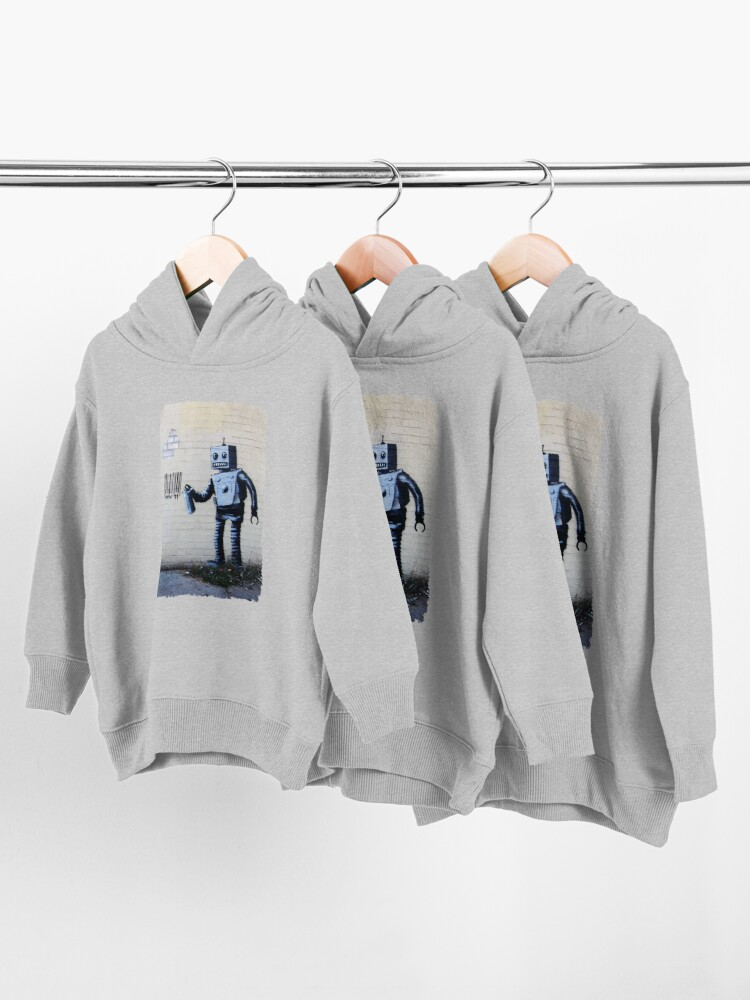 Alternate view of Banksy graffiti smiling Robot and barcodes Better Out Than In New York City residency on brick wall Toddler Pullover Hoodie