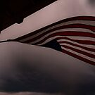 Flag in a rainstorm by lillijy97