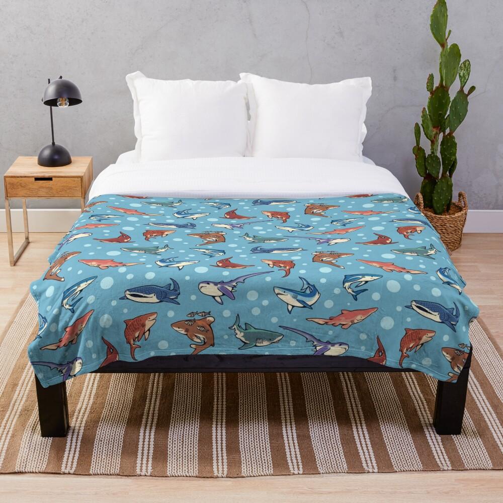 Sharks in the light blue Throw Blanket