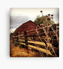 Weathered Fence Posts with Rustic Red Barn Canvas Print