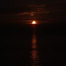 Sea Sunsets over Wales V (or Sun Crescent) by XtomJames