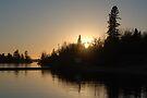 Lake of the woods sunset by Brenden Bencharski