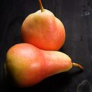 Two Pears On Black Table by SpicieFoodie