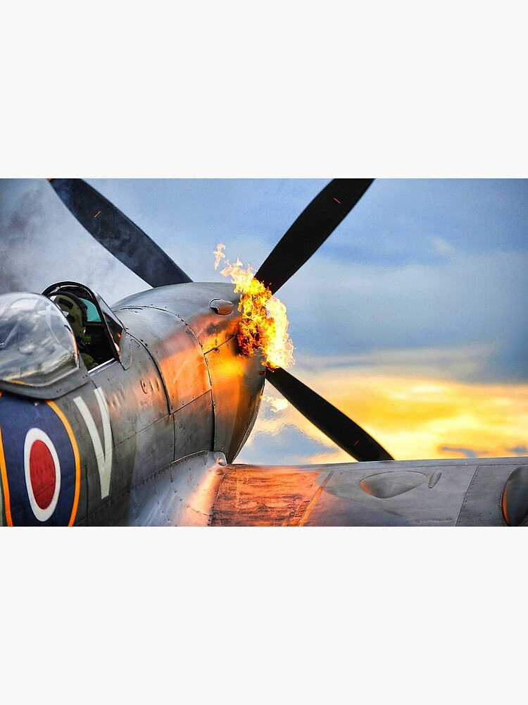 Spitfire airplane of the RAF doing a firy hot start showing flames by liesjes