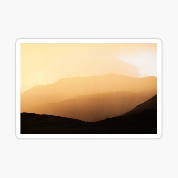 Highland mountain sunset through mist and rain Sticker