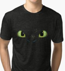 Toothless fiery eyes Tri-blend T-Shirt