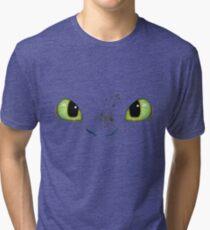 Toothless fiery eyes Tri-blend T-Shirt
