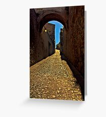 Old arch over narrow street in Caceres Greeting Card