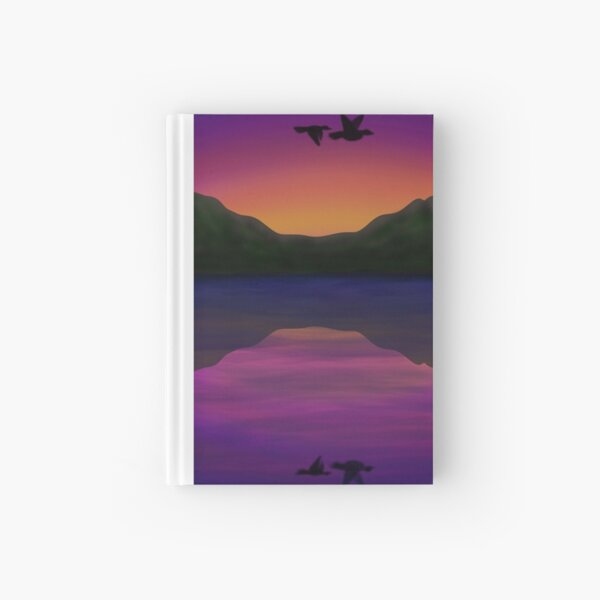 Birds flying above water at sunset Hardcover Journal