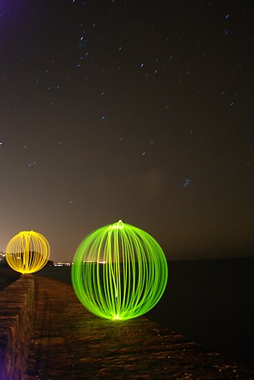 Light orbs on the Sea wall by RedHand