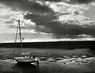 Yacht at low tide - Burnham Overy Staithe, Norfolk, UK by Richard Flint