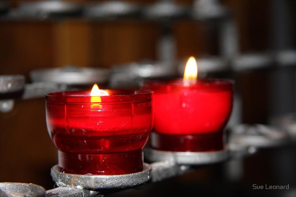 Candles in red holders by Sue Leonard