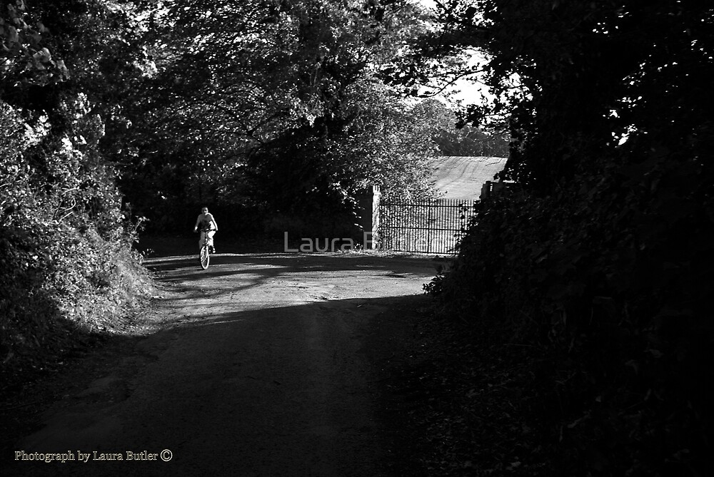 Nearly Home - Cyclist on the Road to Garrykennedy, County Tipperary. by Laura Butler